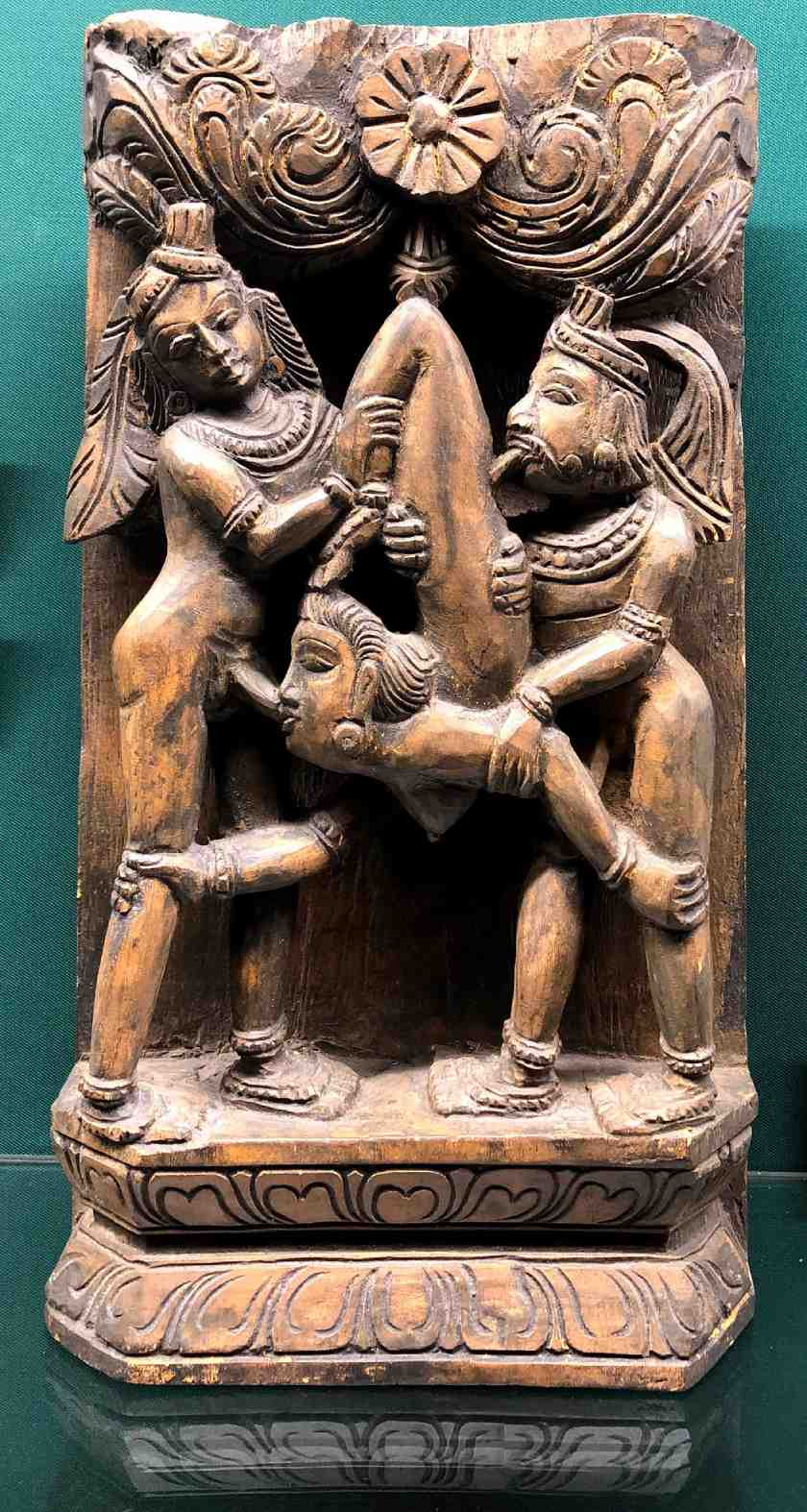 Ancient medieval totem of three people in a sexual position in the Sex Museum in Amsterdam
