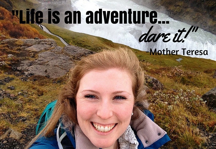 "Mel smiling in front of the Gulfoss falls in Iceland selfie style with the quote ""Life is an adventure…dare it!"" by Mother Teresa, International Missionary at the top of the image"