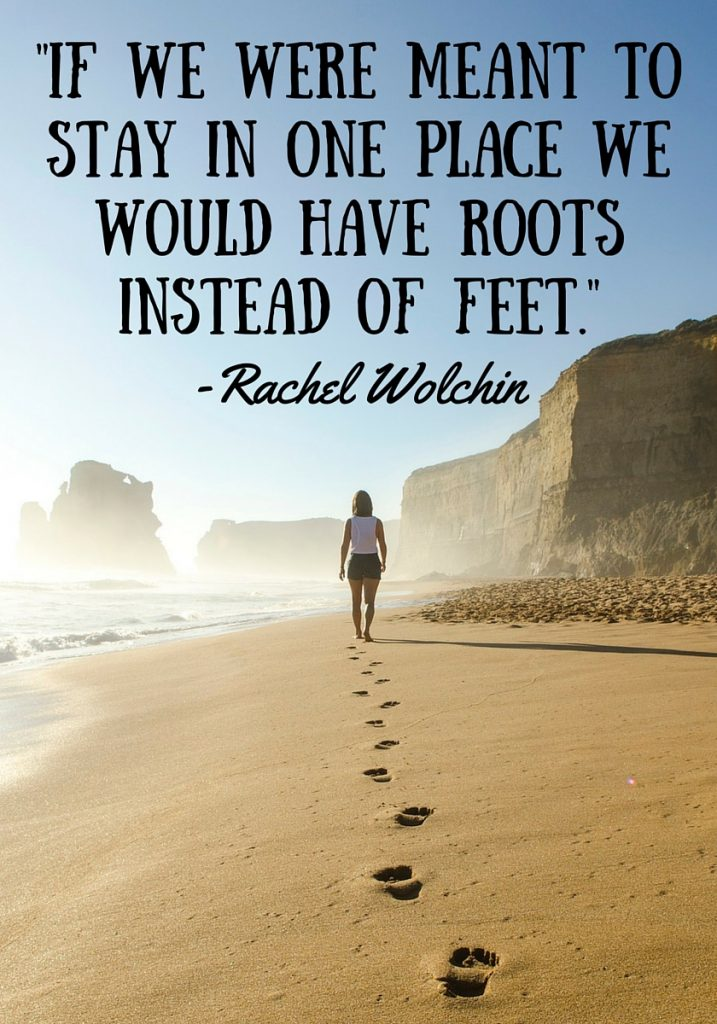 """Girl walking away on a beach leaving footsteps in the sand with the quote """"If we were meant to stay in one place we would have roots instead of feet."""" by Rachel Wolchin"""