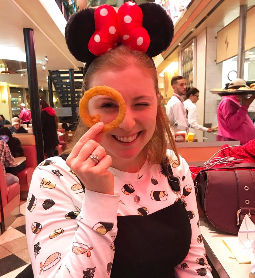 dinner option, mel holding onion rings, inside annettes diner, disney village, how to eat vegan at disneyland paris