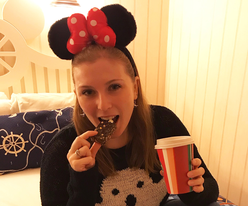 mel eating chocolate crisp vegan cake from starbucks, coconut milk hot chocolate from starbucks, disney village, how to eat vegan at disneyland paris