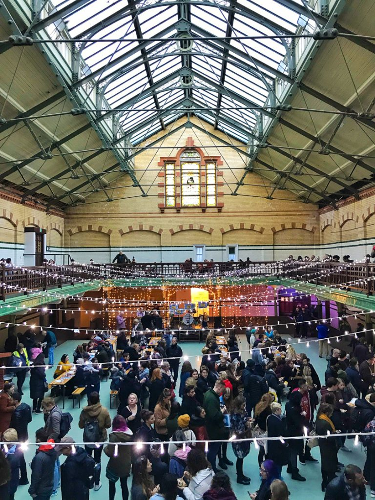Sports Hall, food hall, christmas lights, inside Victoria baths, guide to Manchester's vegan Christmas Festival