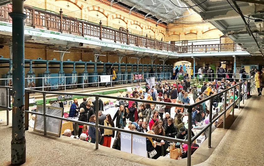 vegan christmas stalls, inside Victoria baths, guide to Manchester's vegan Christmas Festival