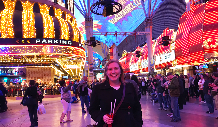 Mel holding a yard cocktail at the Fremont Street experience, top things to do in downtown Las Vegas for non gamblers