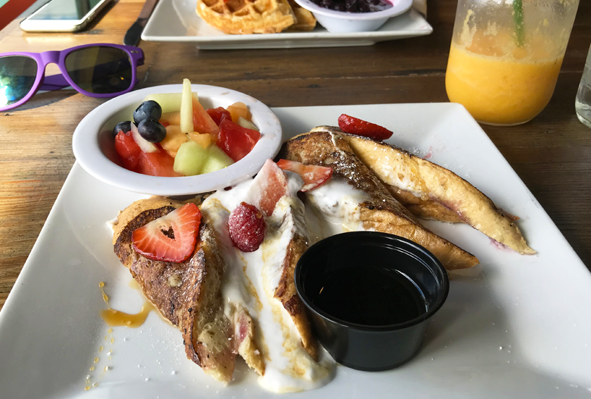 French toast with cream cheese and jam filling with a side of fruit at vegenation downtown las vegas