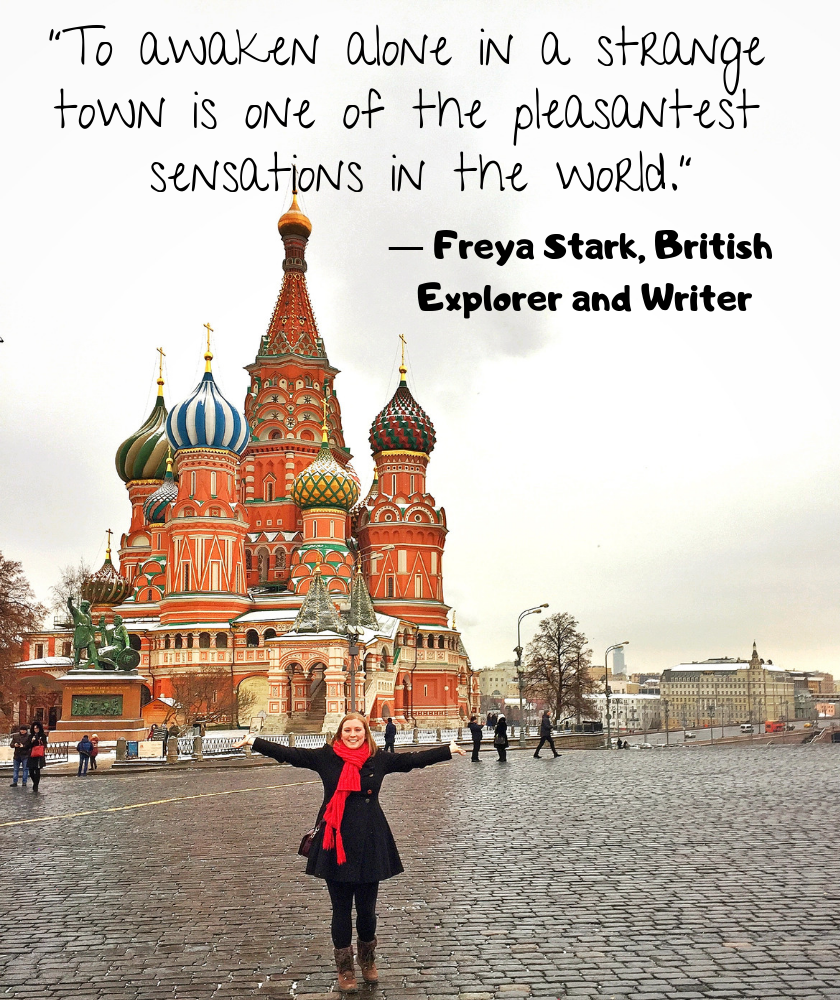 "Mel holding her arms out in front of the Saint Basil's Cathedral in Red Square Moscow with the quote ""To awaken alone in a strange town is one of the pleasantest sensations in the world."" by Freya Stark, British Explorer and Writer"