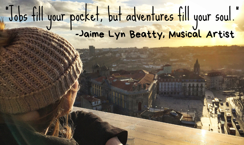 "Mel looking out onto Porto city centre in Portugal from the cathedral balcony with the quote ""Jobs fill your pocket, but adventures fill your soul."" by Jaime Lyn Beatty, Musical Artist"
