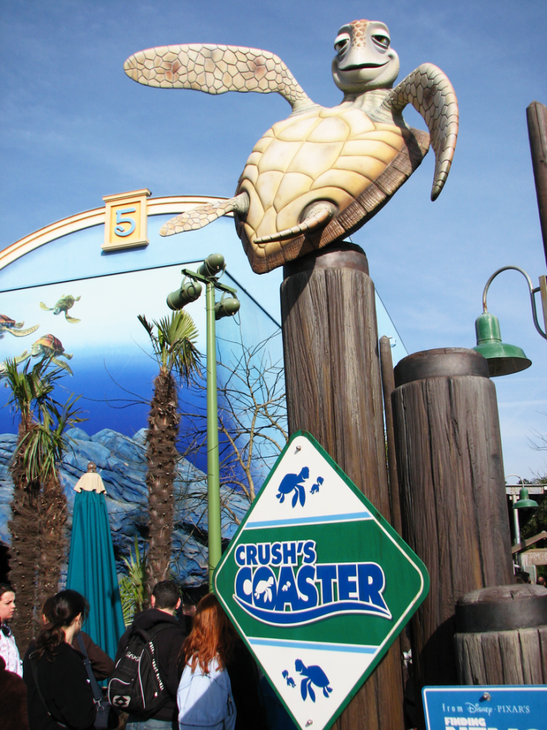 Front of the Crush's coaster ride at Disneyland Paris with turtle and sign