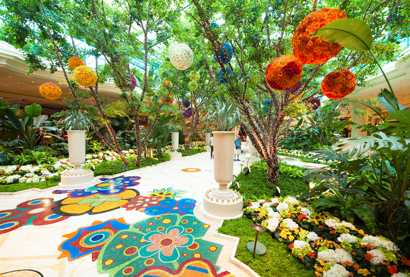 Inside the lobby area of the Wynn hotel in Las vegas with bright and flowery decor