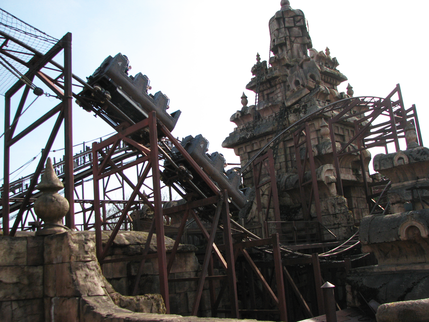 Indiana jones ride at Disneyland Paris car going over tracks above with temple in background