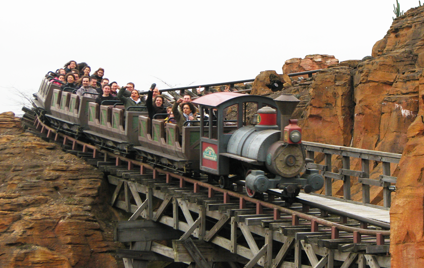 People screaming from joy on the Thunder Mountain ride at Disneyland Paris as the train runs round the tracks