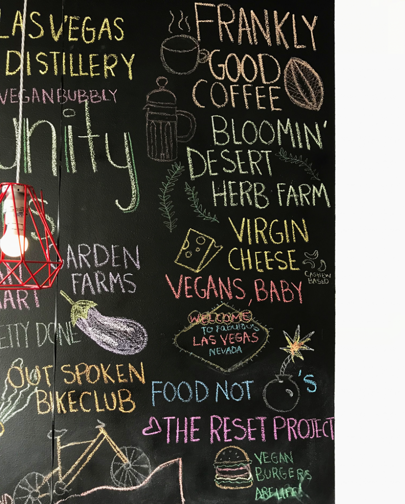 chalk board with vegan messages on it at vegenation downtown las vegas