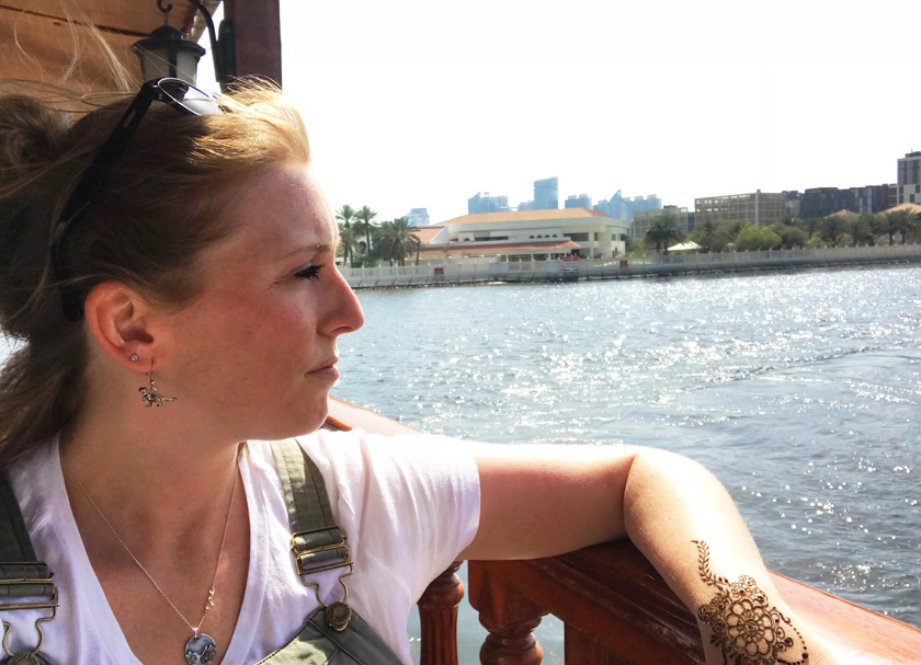 Mel from Footsteps on the Globe side on looking onto Dubai Creek from an open river boat window, Breaking up, backpacking and beginning again