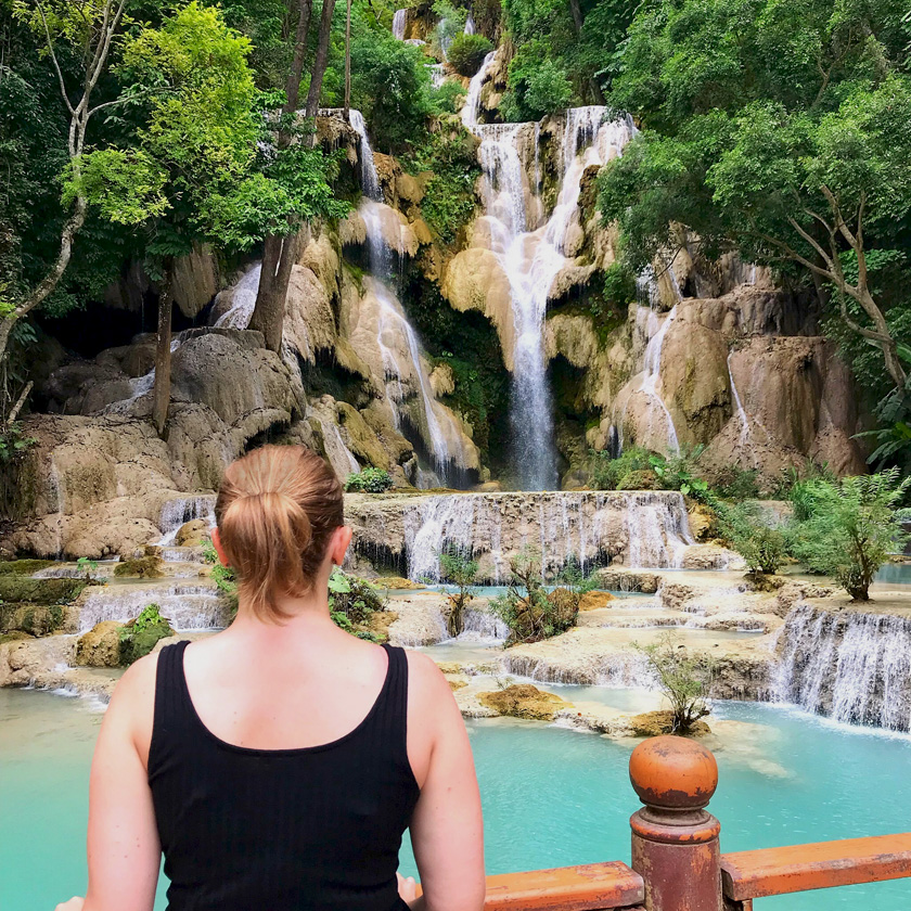 Mel from Footsteps on the Globe stood in front of a waterfall in Luang Prabang in Laos, Breaking up, backpacking and beginning again