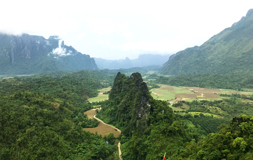 Mountains and greenery in Laos, Breaking up, backpacking and beginning again