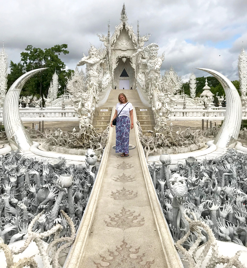 Mel from Footsteps on the Globe crossing the bridge to the Wat Rong Khun 'White Temple' in Chiang Rai in Thailand, Breaking up, backpacking and beginning again