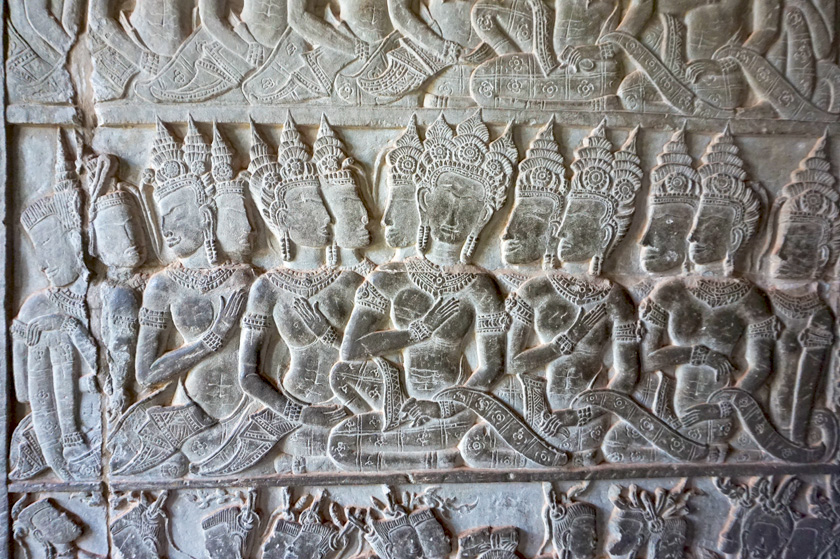 Carved wall with religious figures.