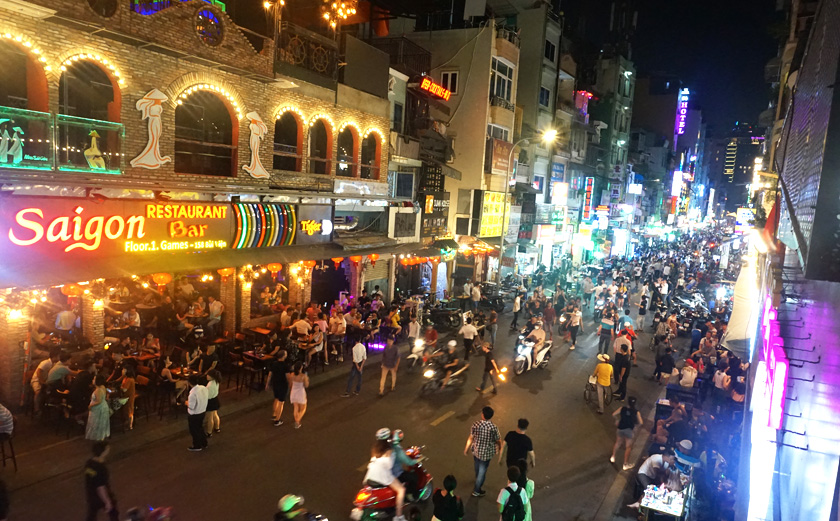 Partying district with a busy road full of traffic in Ho Chi Minh City in Vietnam
