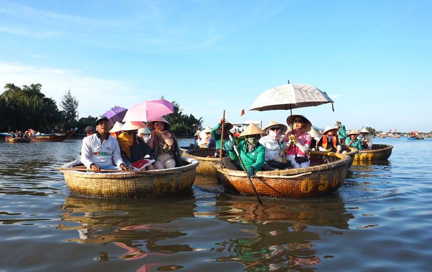 People in basket boats in Hoi An in Vietnam