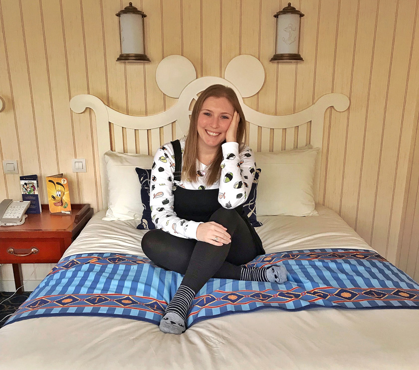 Mel from Footsteps on the Globe sat on a Mickey mouse shaped bed at the Newport Bay Club Hotel at Disneyland Paris, Reasons to go to Disneyland Paris