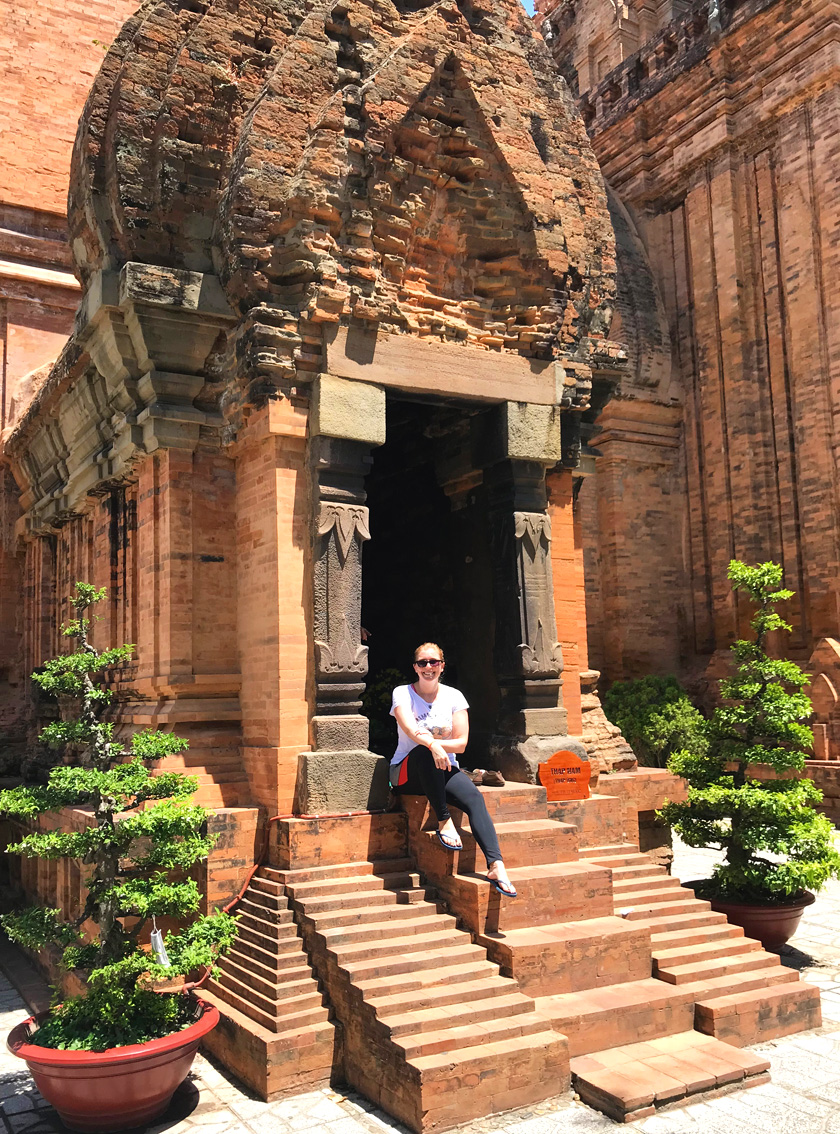 Mel from Footsteps on the Globe sat at the entrance of one of the temples at Ponagar Towers in Nha Trang in Vietnam