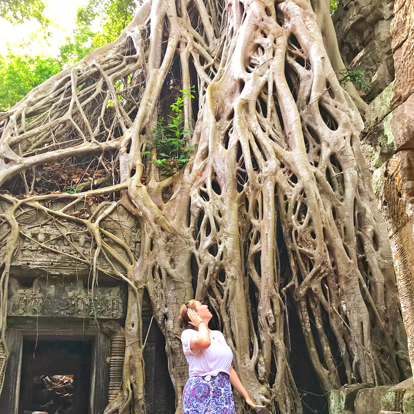 Mel from Footsteps on the Globe looking up at vines enveloping a temple where Tomb Raider was filmed.
