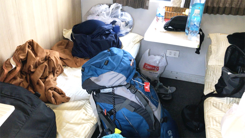 Lots of bags on the floor and bottom bunk beds on the overnight train in Vietnam