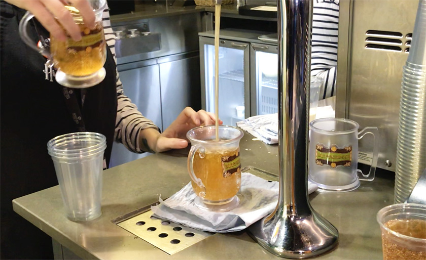 Vegan Buttebeers being poured without the cream into tankards