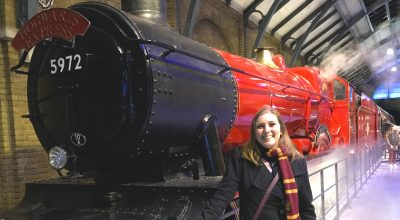 Mel in front of the Hogwarts Express red train
