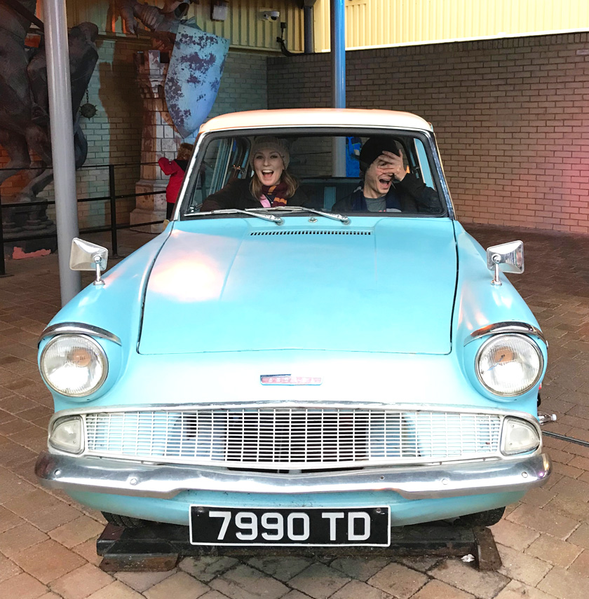 Mel from Footsteps on the Globe and her boyfriend in the blue flying car from Harry Potter 2 on the backlot of the Harry Potter Studios Tour