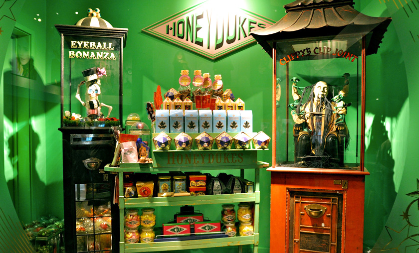 Non-vegan Honeydukes green candy corner display with a skeleton in a glass case