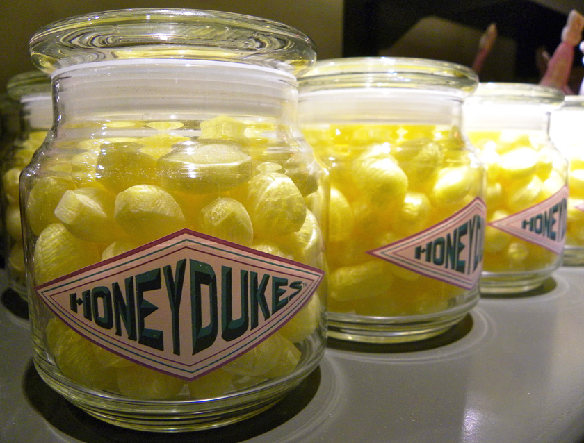Non-vegan sherbet lemon hard candies in glass jars with Honeydukes on the label