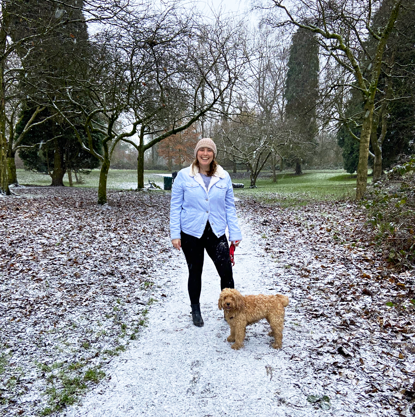 Mel taking Lilly the cockapoo for a walk in the park in the snow