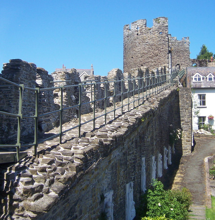 Medieval town walls in Conwy with railings.