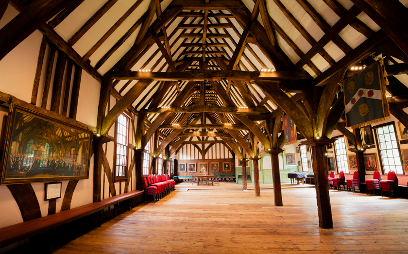 Inside the Merchant Adventurers' Hall in York with medieval wooden beams and wood flooring