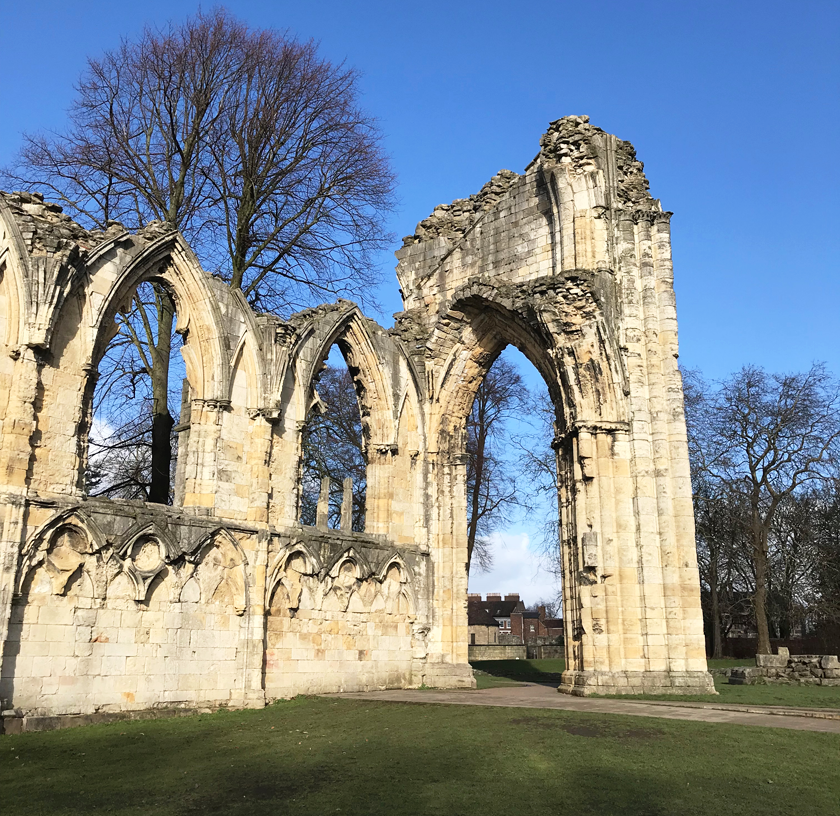 St Mary's Abbey York ruins beige arch and green grass