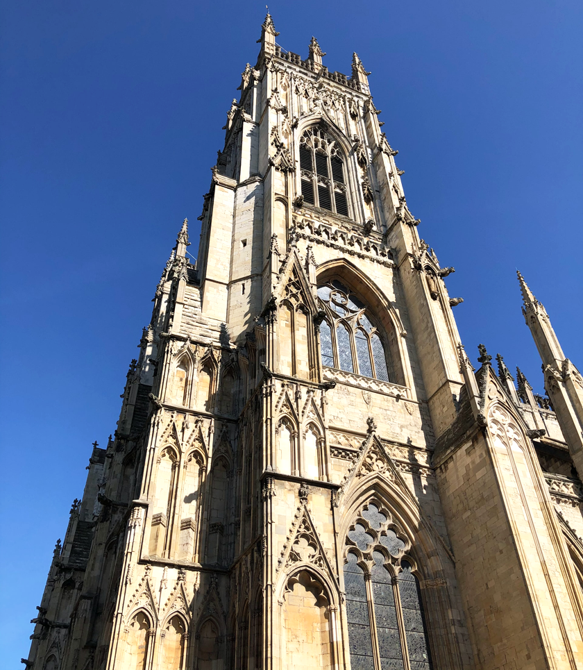 Outside York Minster, a grand cathedral against a blue sky in York, UK
