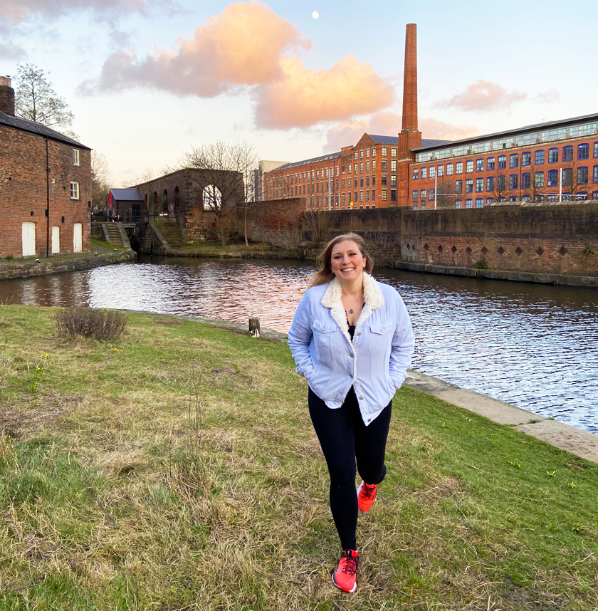 Mel walking by the canal in Ancoats Manchester at sunset