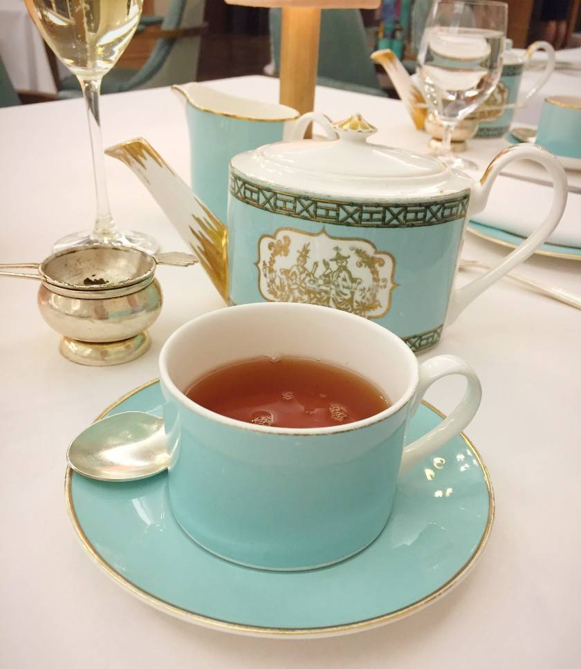 Close up of a cup of black tea served from a Fortnum and Mason green teapot