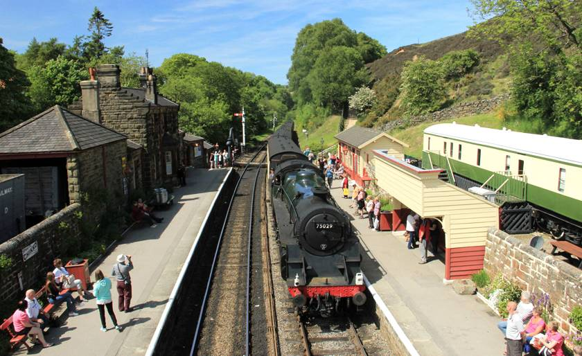 GoathlandRailway Station in Yorkshire with an old fashioned locomotive on the tracks which was the location of Hogsmead in Harry Potter and the Philospher's Stone