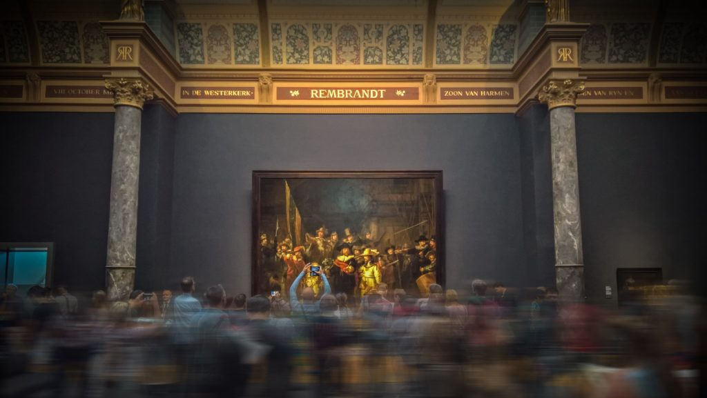 Rembrandt painting with a crowd in front it at the Rijks Museum in Amsterdam